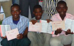 Children in Mozambique enjoy getting their first Bibles and learning about the Lord.
