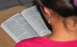A Christian woman in El Salvador studies the Bible to bring Jesus Christ into her life