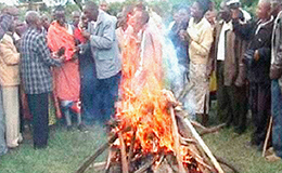 The flames of a bonfire near a Chuch in Nigeria consume the idols formerly worshipped by a young Nigerian man.