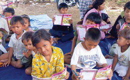 Cambodian kids study the Bible training materials from their local village church to learn how to fulfill the great commission.