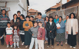 Young Christian Bulgarian gypsy with his family that he hopes to save with Bible Study.